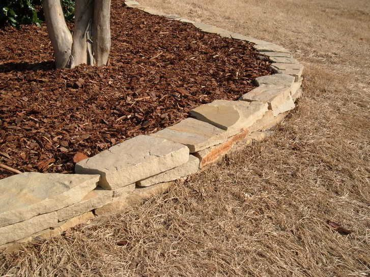 Flagstone stack. Gives your yard definition and keeps your