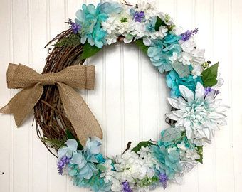 blue floral wreath with burlap bow  wreathsbycasey