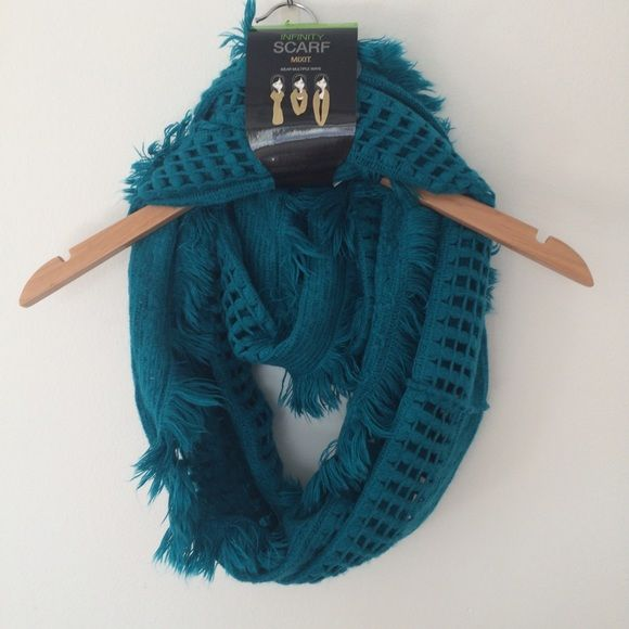 Spring Infinity Scarf Bright teal blue infinity scarf. Beautiful knit pattern and very soft! 100% acrylic. Can be worn multiple ways. Mixit Accessories Scarves & Wraps