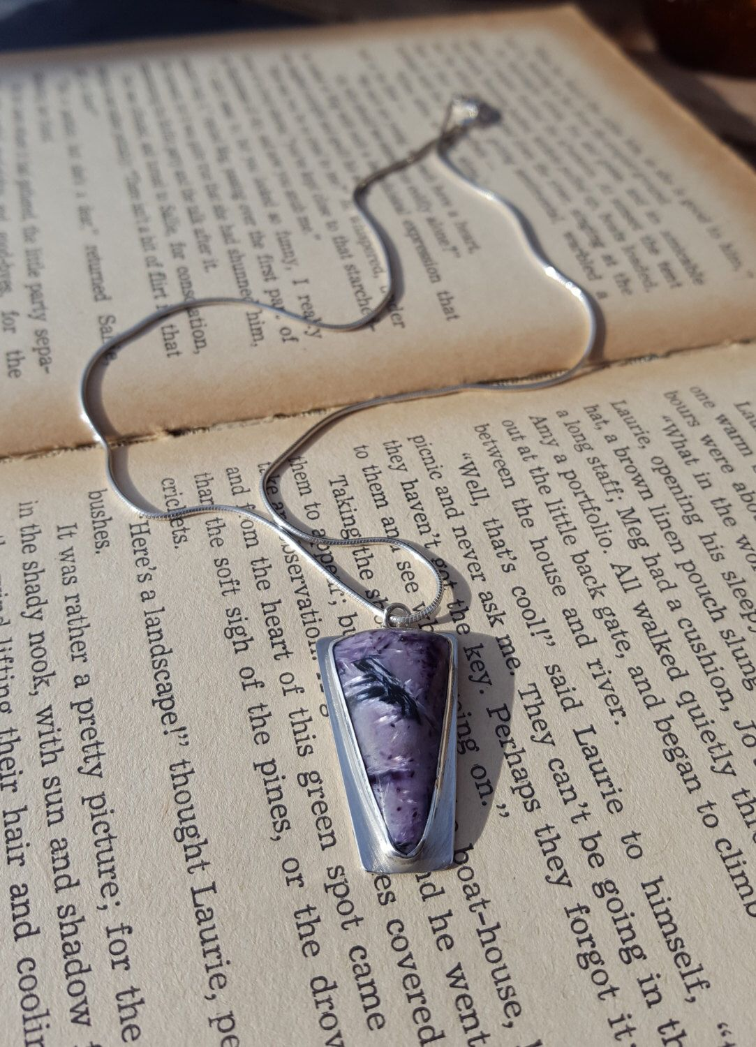 A personal favourite from my Etsy shop https://www.etsy.com/uk/listing/474560116/charoite-pendant-sterling-silver-bezel