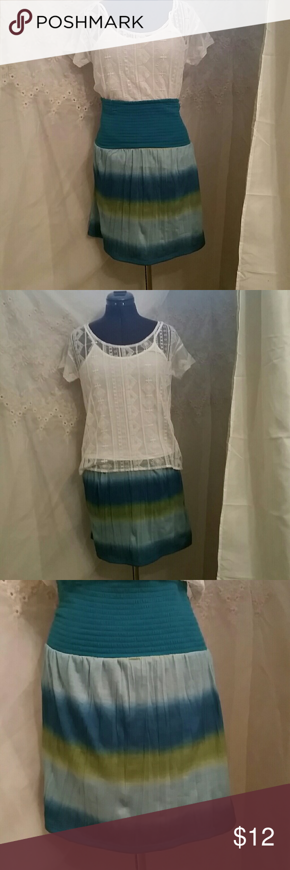 NWOT BEAUTIFUL SKIRT This adorable skirt is in excellent condition. Never been wore. Turquoise, light blue and mustard yellow.  Tie dyed. High waisted. Maurices Skirts
