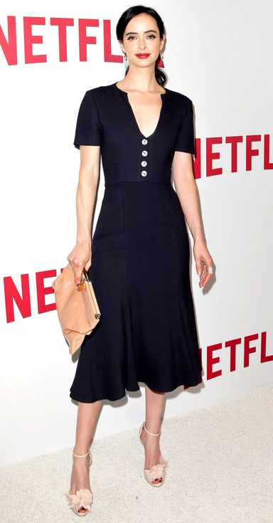 Krysten Ritter in a black midi dress