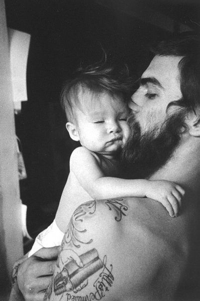 Dash Snow. Bearded man w tattoos and a baby.