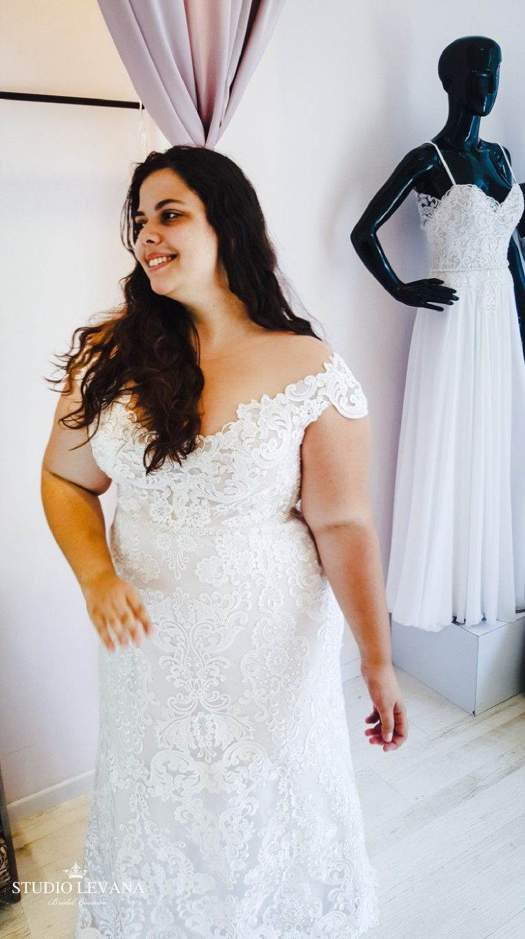 Plus size white wedding dress  Real plus size bride in a full lace fitted wedding gown with off