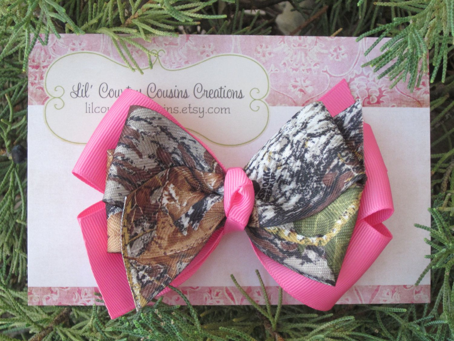 Mossy oak camo and hot pink hair bow on clip big bow great for