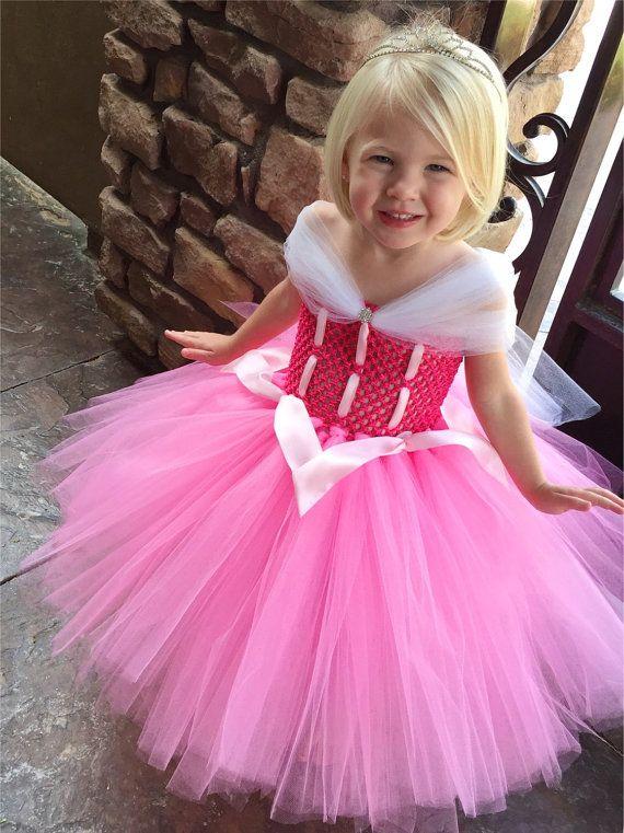 ac99b43b0 This beautiful Aurora Princess Dress is reminiscent of the pink ...