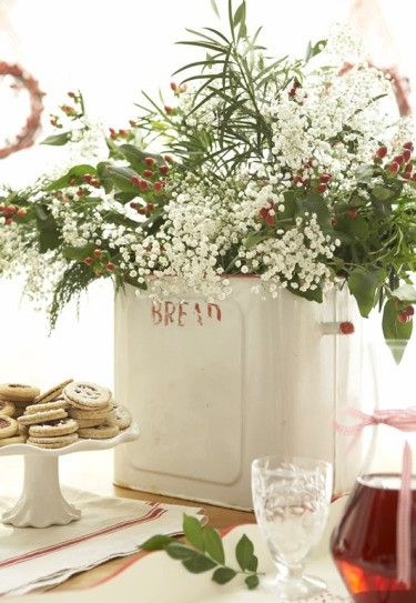Use a kitchen object to hold the flowers when setting up a buffet on the kitchen island.