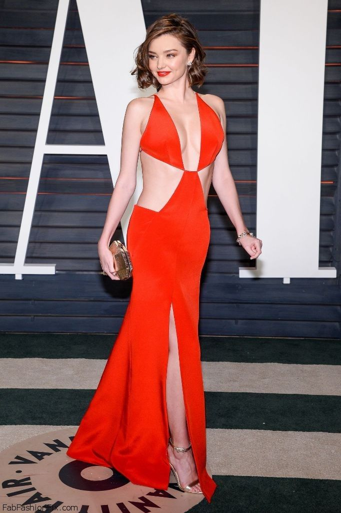 Miranda Kerr shows her abs in Kaufmanfranco red gown at the 2016 ...