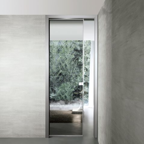 The Spin door is fitted with a Rimadesio patented magnetic lock an exclusive design that reflects the new approach to opening and closing mechanisms. & aluminium frame in titanium finish and reflecting grey glass | Doors ...