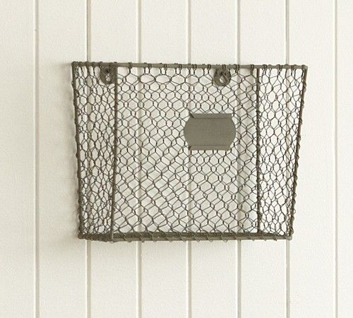 basket for papers, school papers, mail, fruits, veggies- just like it. Hangs on a wall