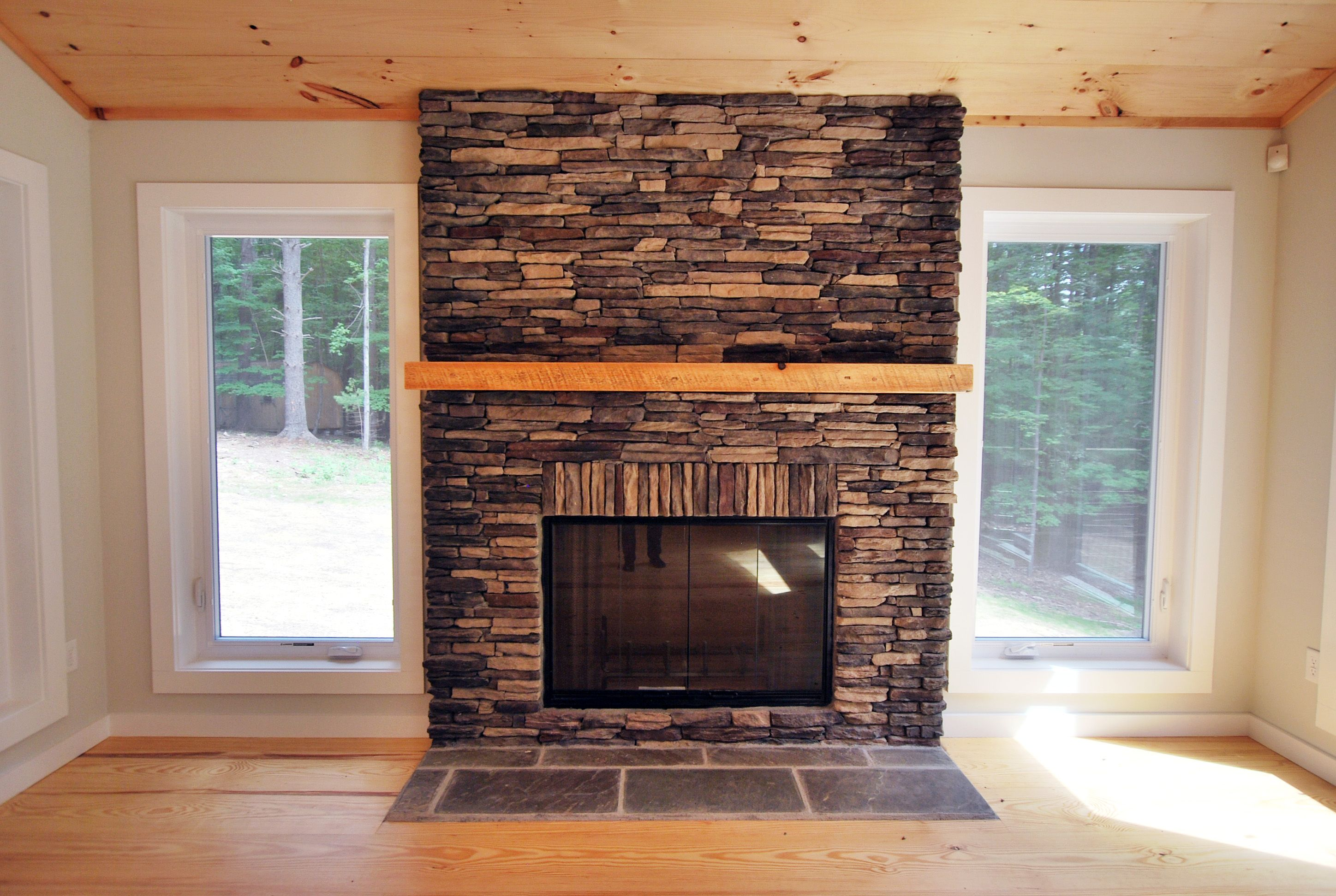 tennessee laurel cavern ledge stone with a smooth beam mantel