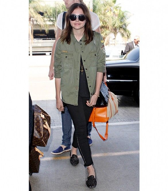 Chloë Grace Moretz:  At WhoWhatWear.com, we appreciate a good army jacket, which is why we want to recreate Moretz's recent travel ensemble, like now. In a black shirt and jeans, she let her patched army jacket and animal-print slippers serve as her outfit's standout pieces. To shield herself from the paparazzi's flashes, she chose a pair of oversized Dior sunglasses.