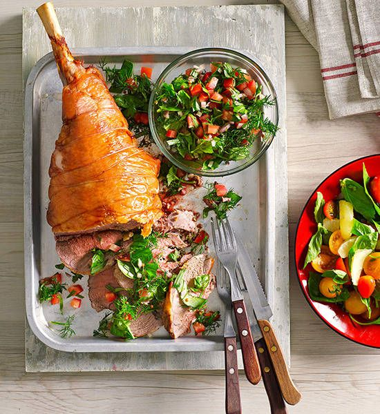 barbecue roasted lamb leg with fresh herb sauce and colourful tomato salad don t be sheepish about serving this beauty with tender lamb herby