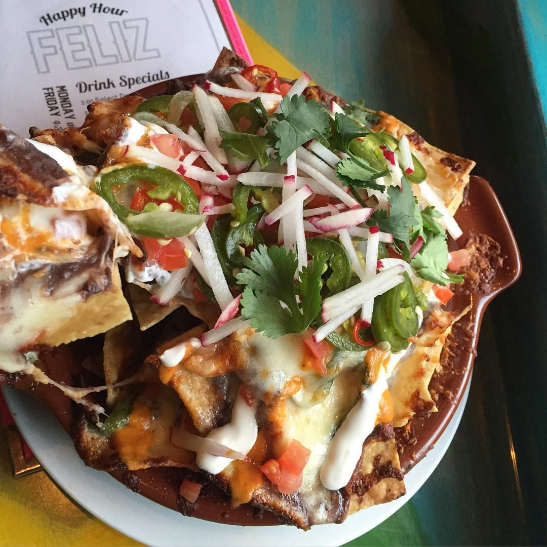 , Nachos (Queso Mixto, Black Bean Purée, Rajas, Pickled Jalapeños, Salsa Arbol, Tomatoes, Crema, and Radish) Chicken Tinga