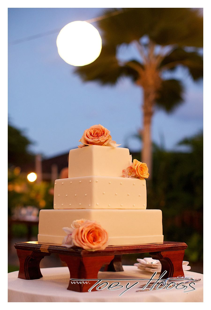 Clean and modern square cake with floral accents and center tier