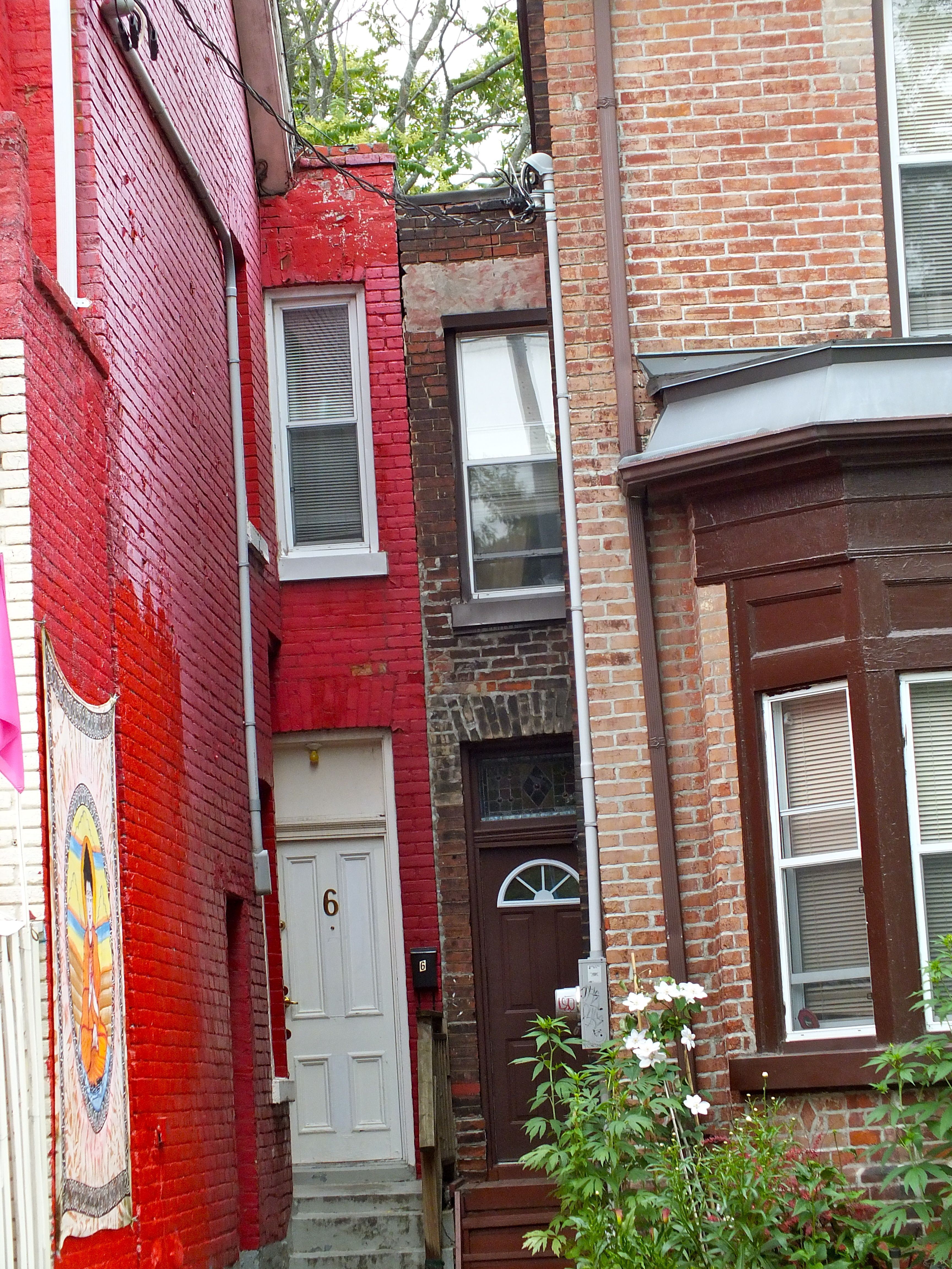 We saw Two very small houses in Kensington Market Toronto,Ontario, Canada June 27, 2013