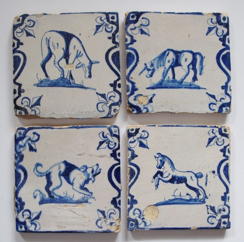 4 Antique socalled baluster Delft delftware tiles with roe unicorn dog horse..