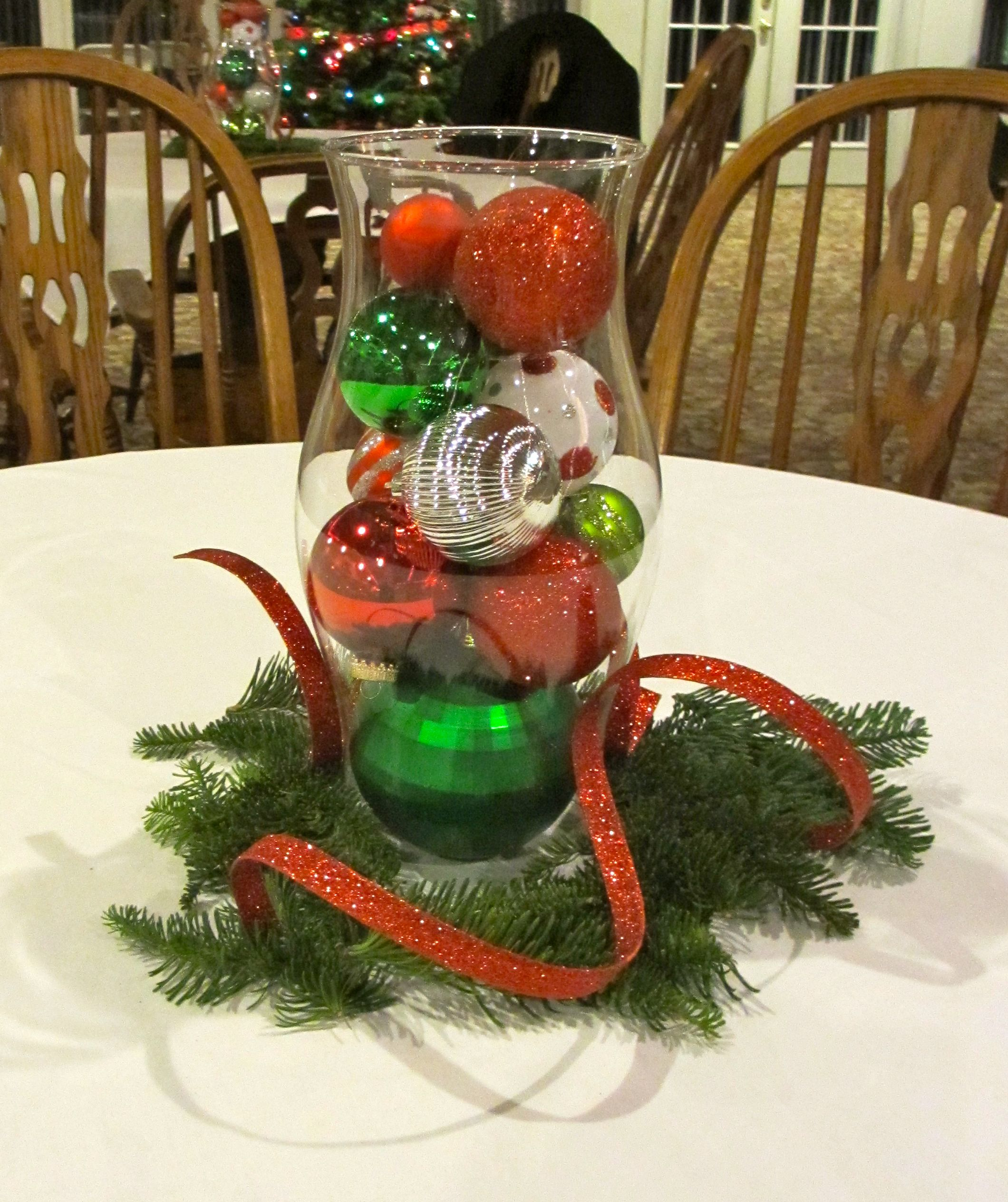Christmas table centerpiece with fresh greenery