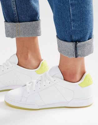 4b0a0bc8e2c Reebok NPC II Trainers With Yellow Heel And Sole Detail