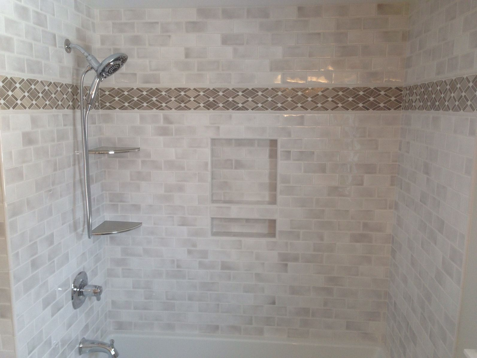 Custom tub surround featuring a traditional 3x6 subway tile with custom tub surround featuring a traditional 3x6 subway tile with stone mosaic for dailygadgetfo Choice Image