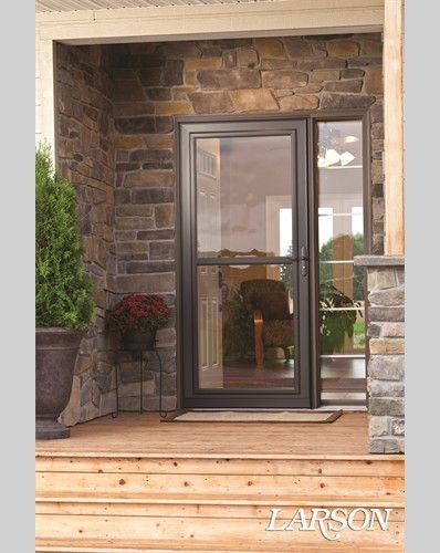 A brown storm door brings together the elements of this for Entry door with storm door