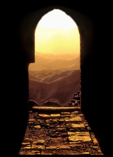 """EDITOR'S PIC OF THE DAY Photo: RAYMOND GEHMAN Hebei Province, The Great Wall """"Jinshan Ling"""": The setting sun is framed by a tower portal in The Great Wall."""