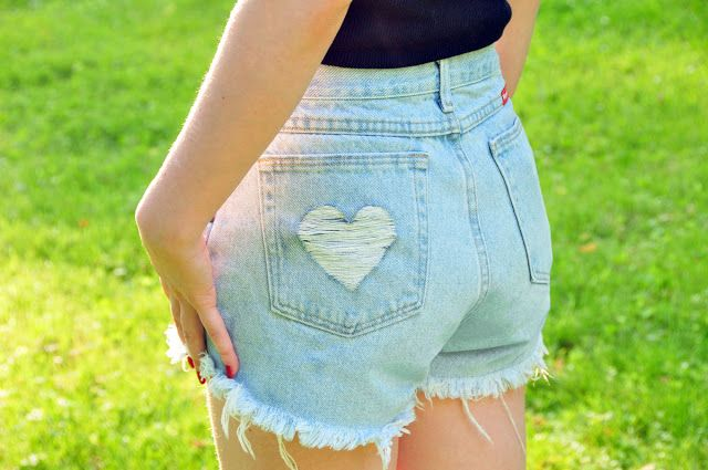 In depth tutorial on how to turn boys' or men's pants from Walmart (can you say cheap?) into cute, high-waisted cutoff shorts.