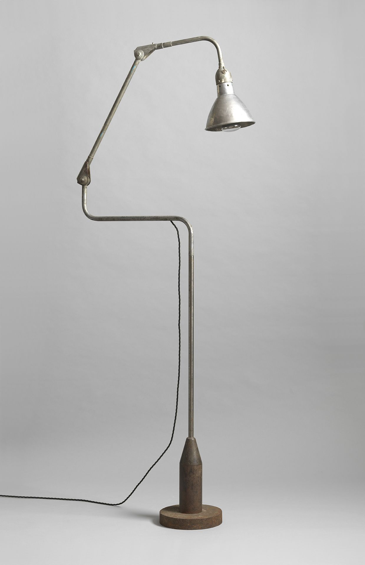 "Available at Robert Young Antiques: Unusual Industrial Vintage Task Lamp, With Articulated Metal Stem, Northern European, c1920, 62"" high x 34"" wide x 9"" deep."
