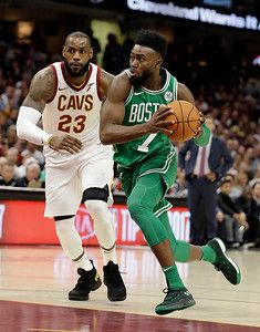Boston Celtics\' Jaylen Brown (7) drives past Cleveland Cavaliers\' LeBron  James (23) in the first half of an NBA basketball game, Tuesday, Oct. 17,  2017, ...