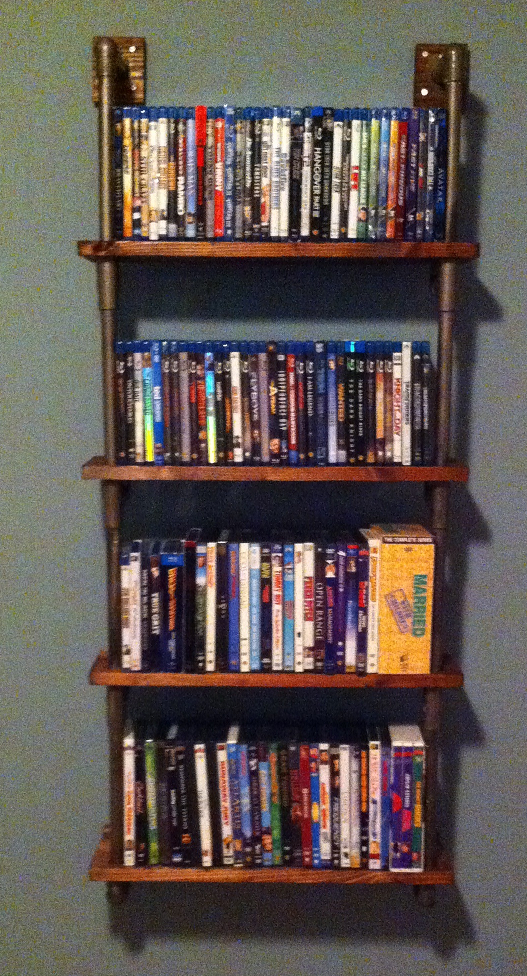 A Jamie Custom This Dvd Rack Was Modeled After Other Pipe Shelves Found On Pinterest But Used Plastic Pvc And Wood Anchors Instead Of Floor
