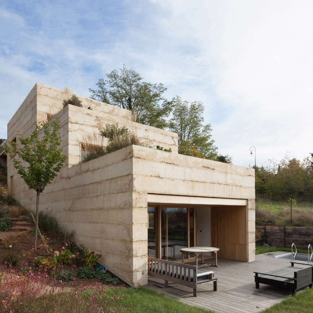 Tectoniques Sets Ochre Coloured Concrete House Into French Hillside In 2020 Concrete House Larch Cladding House