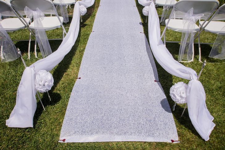 How To Secure A Wedding Aisle Runner On The Grass For An Outdoor Wedding Aisle Runner Wedding Wedding Aisle Outdoor Wedding Aisle