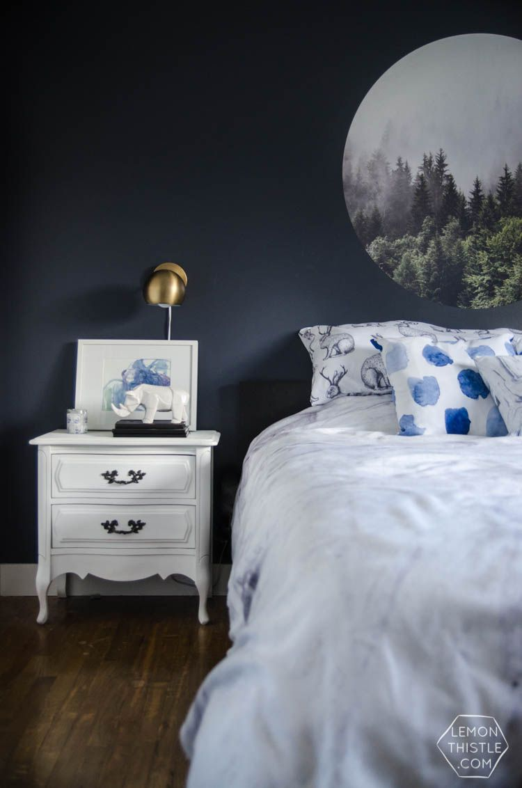 Master bedroom gallery wall  I LOVE this moody navy bedroom the forrest the gallery wall the