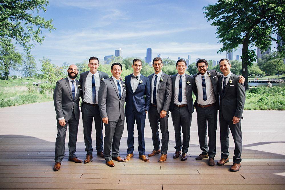 Groom In A Navy Suit Groomsmen In A Grey Suit With Navy Ties