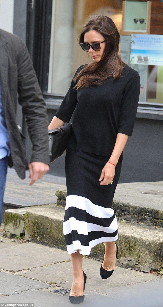 Victoria Beckham is super chic in a monochrome midi skirt ...