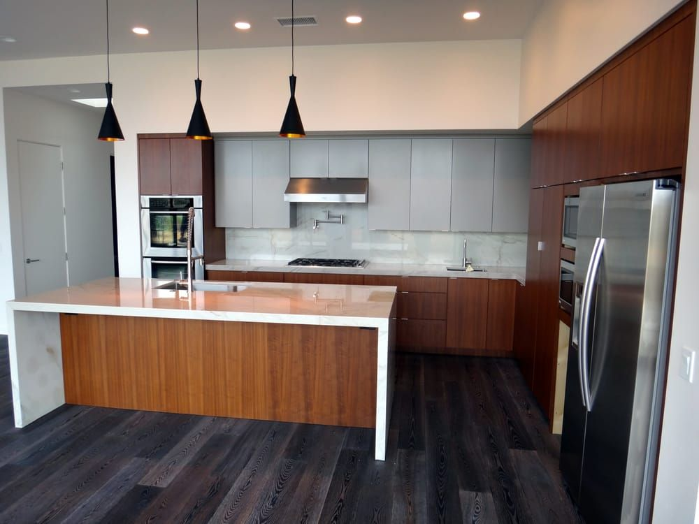 Kitchen Cabinets Repair Contractors Modern style flat panel doors and moldings. Quarter sawn walnut