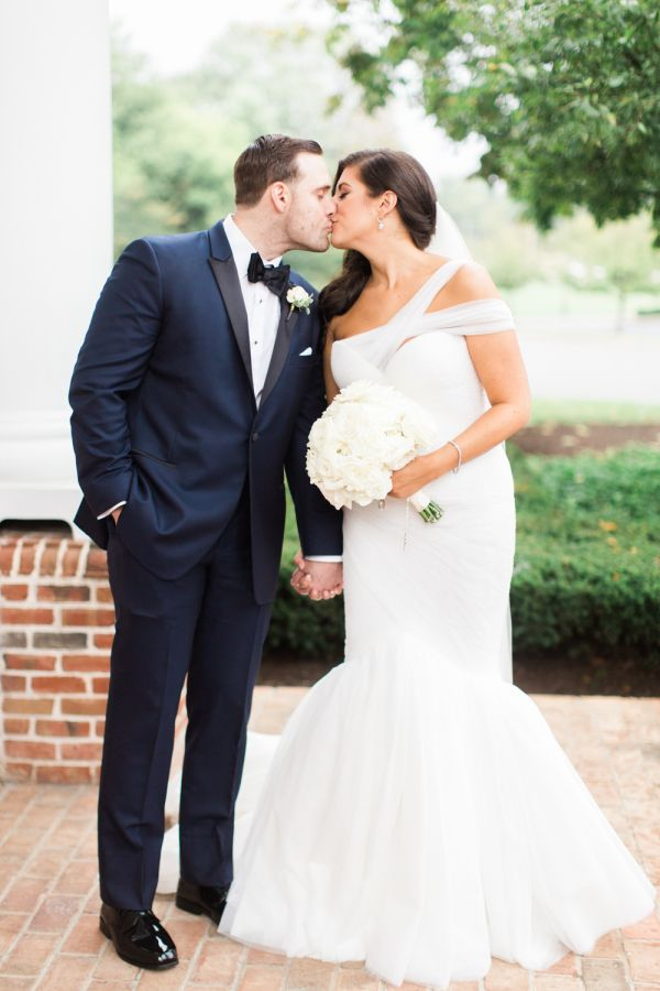 Modern fit & flare wedding dress: http://www.stylemepretty.com/ohio-weddings/2016/02/01/elegant-ohio-blush-ballroom-wedding/ | Photography: Lauren Gabrielle - http://laurengabrielle.com/