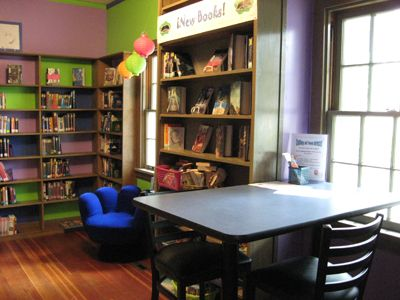 Columbia County Rural Library District Teen Area. Put colored paper behind shelves to add some life to the YA area?