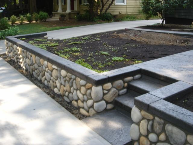 Cultured stone river rock retaining wall planter box for River rock wall