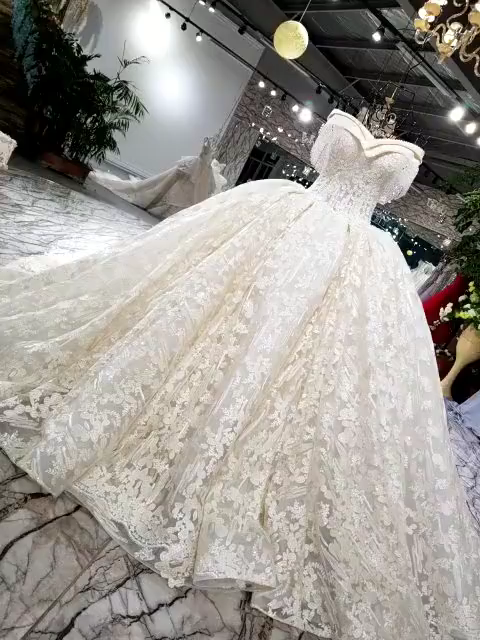 Photo of Luxury beaded off the shoulder Bridal Gowns with cathedral train