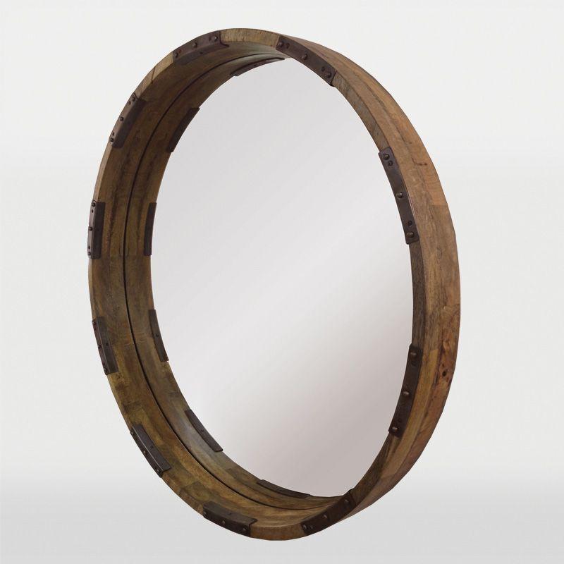Le cadre en bois de manguier et l'accent métallique avec une finition vieillie ajoutent du caractère à ce miroir rond / The mango wood frame  and metal accents in a distressed finish adds character to this round mirror