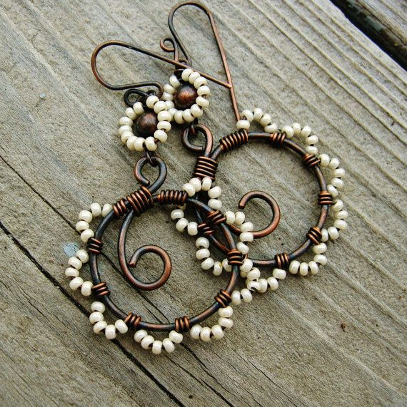 wire-wrapped antiqued copper hoops with beaded petals in cream pearl.