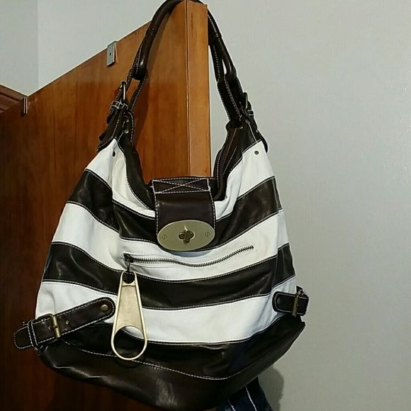 Pretty Brown and white Stripped Bag Bought but never carried this bag, excellent condition Bags