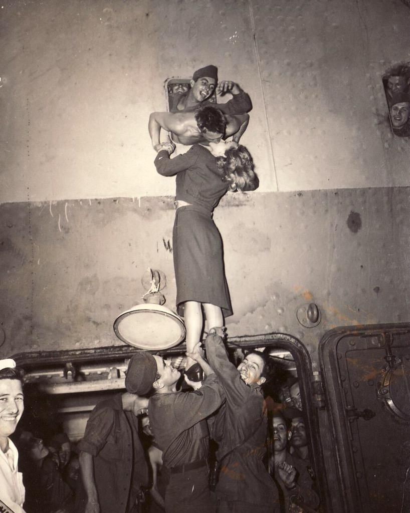 Marlene Dietrich welcomes a soldier returning from World War 2 with a passionate kiss through a porthole, 1945