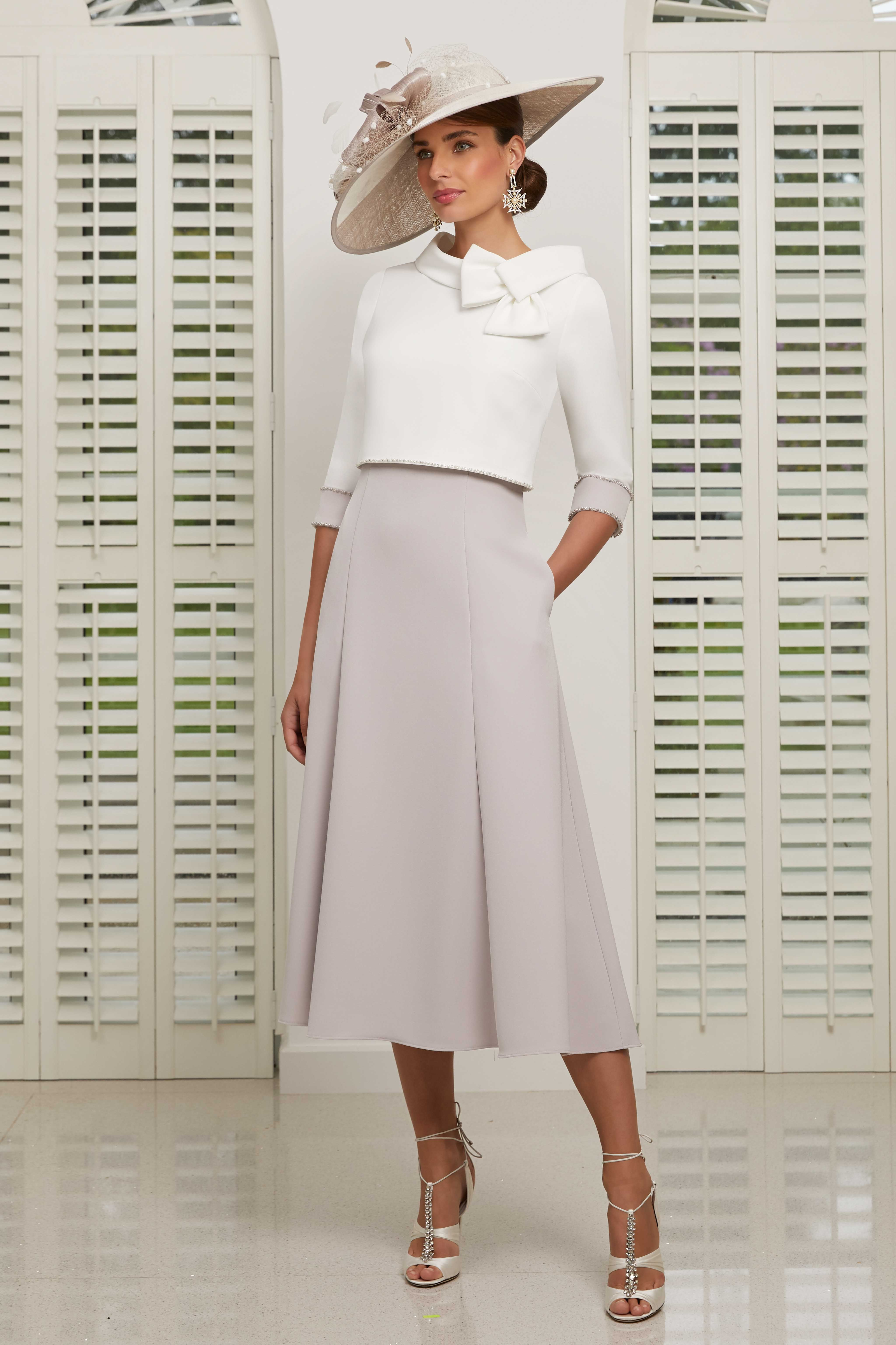 Mid length dress with matching jacket. Veni Infantino