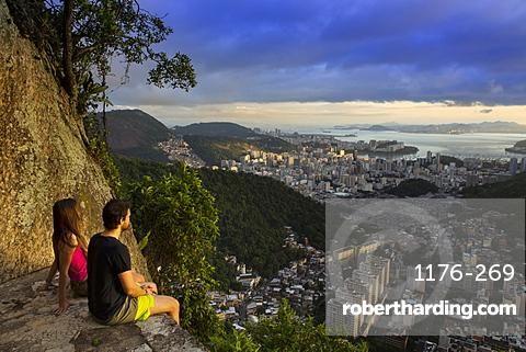 Hikers looking out over Rio from the Morro dos Cabritos, Rio de Janeiro, Brazil, South America