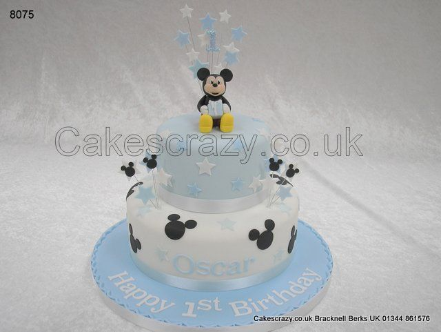 Two Tier Blue On White First Birthday Cake With Mickey Mouse Theme