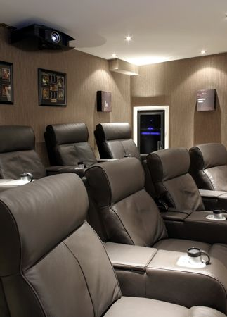 a contemporary home theater room installed by maven a home cinema