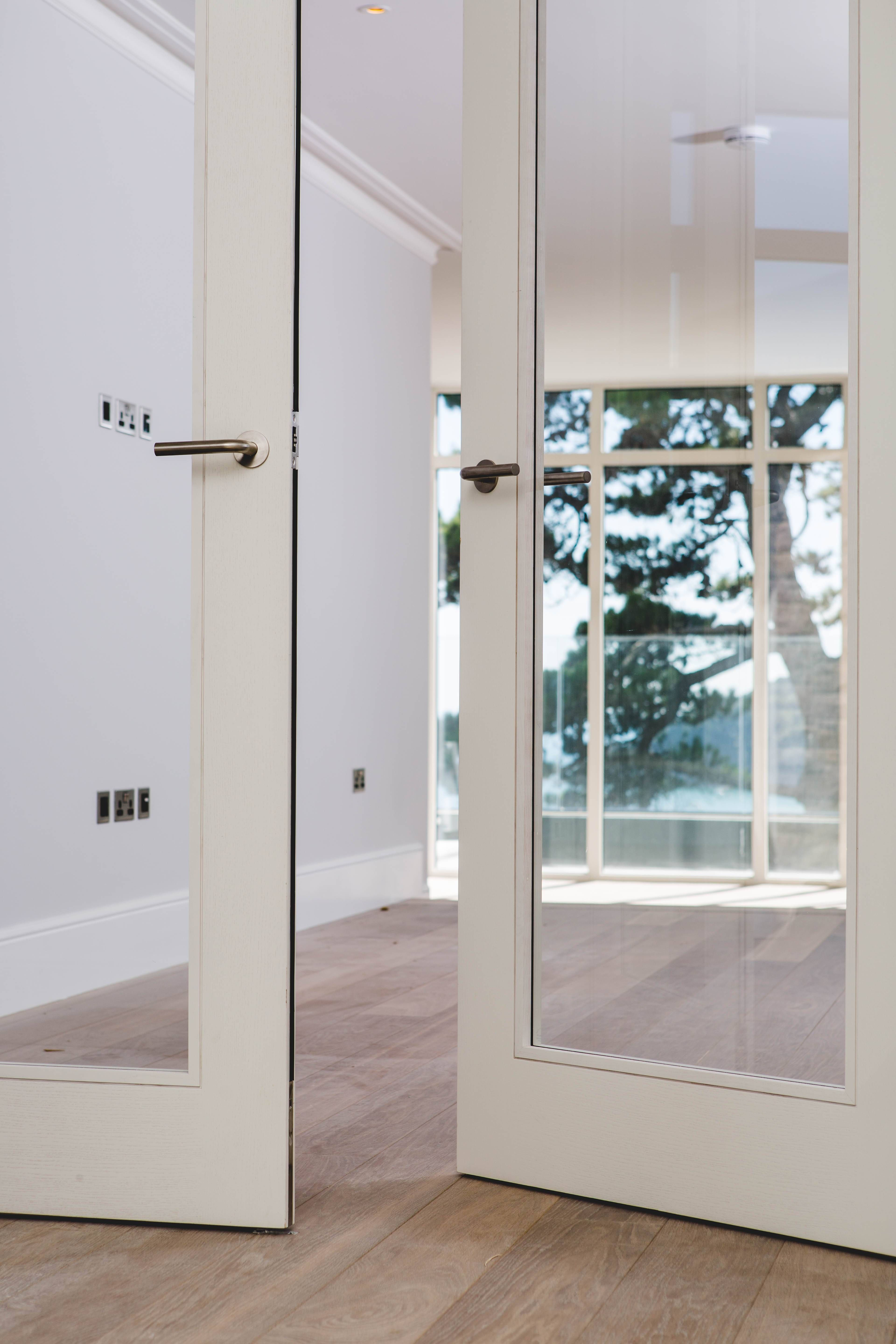 Contemporary White Washed Ash Veneer Trinity Style Double Doors With Large  Vision Panels By Graefe Ltd