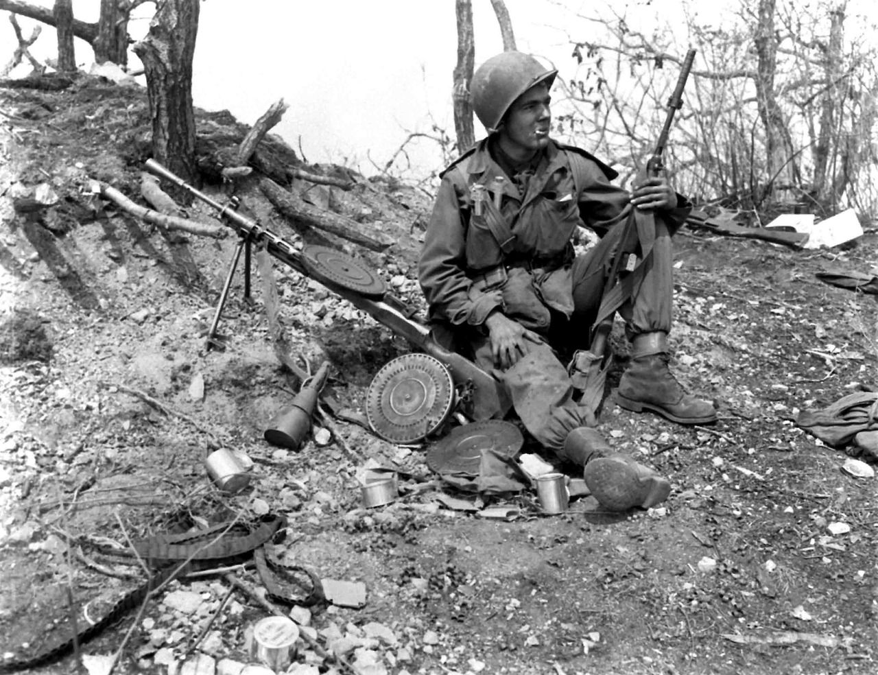 An American soldier with a Russian Degtaryov DP-27 light machine gun. Note the grenade launching adapter on the M1 carbine he is carrying.